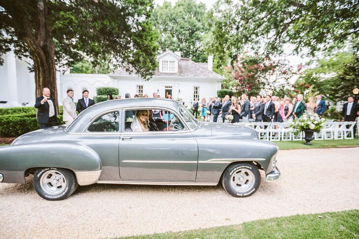 After really struggling to decide how she should arrive at the ceremony, and just days before the wedding, Jessie saw a beautiful 1955 Chevy car parked on the side of the street. After finding the owner, he gladly agreed to drive her up to the ceremony in his classic car.