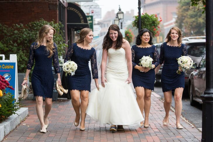 Steph, who wanted her bridesmaids to be able to wear their dresses again, chose the  Zarita navy lace dress from Diane von Furstenberg. They completed their looks with gold shoes and gold knot Kate Spade necklaces.