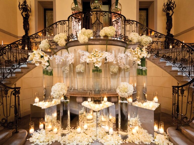 Bryan Rafanelli's luxe reception entrance with mirrors and candles