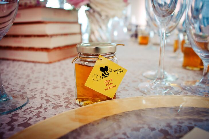 The couple's honey jar wedding favors were made by the Olga and her mother. Each had a simple yellow 'meant to bee' tag.