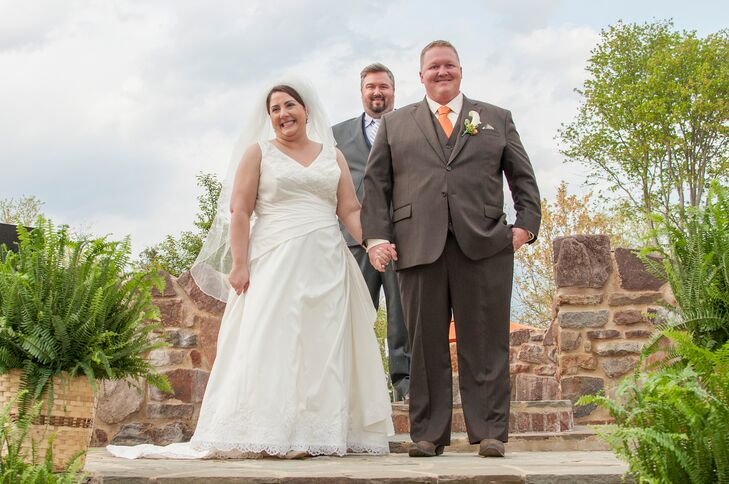 Cheryl and Travis were married by Travis' brother. Cheryl looked radiant in a consignment A-line wedding dress from LaBella Boutique.