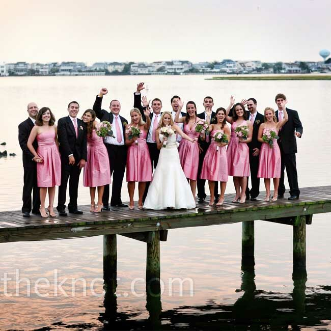 The guys' ties perfectly matched the bridesmaid dresses, which came in strapless and halter styles.