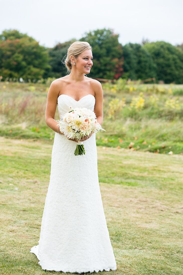 """The team at Madeleine's Daughter helped Caitlin find the right dress for her wedding day. """"My wedding dress was simple and elegant,"""" Caitlin says. """"I wanted something that would match the beauty of the farm."""" She chose an all-lace white strapless dress by Mikaella Bridal."""