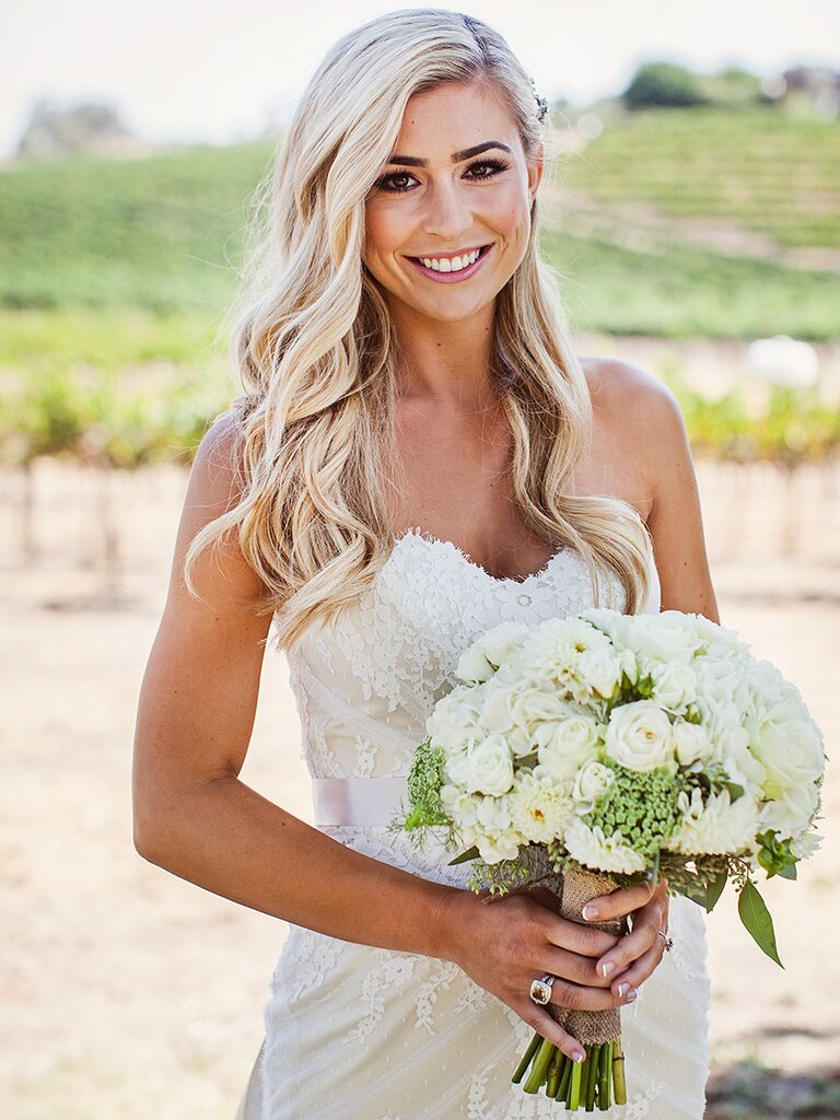 Loose curled wedding hairstyle with half-tucked detail