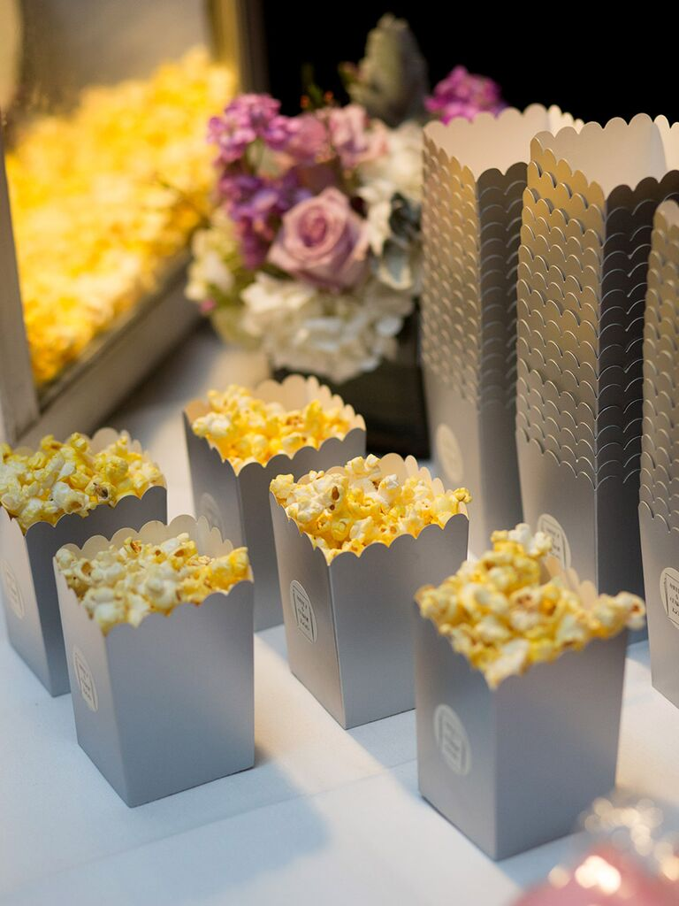 To-go boxes of popcorn for a wedding reception snack