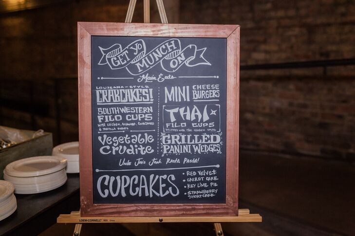 The groom illustrated and hand-lettered all of the signs scattered throughout the reception space -- including this chalkboard menu!