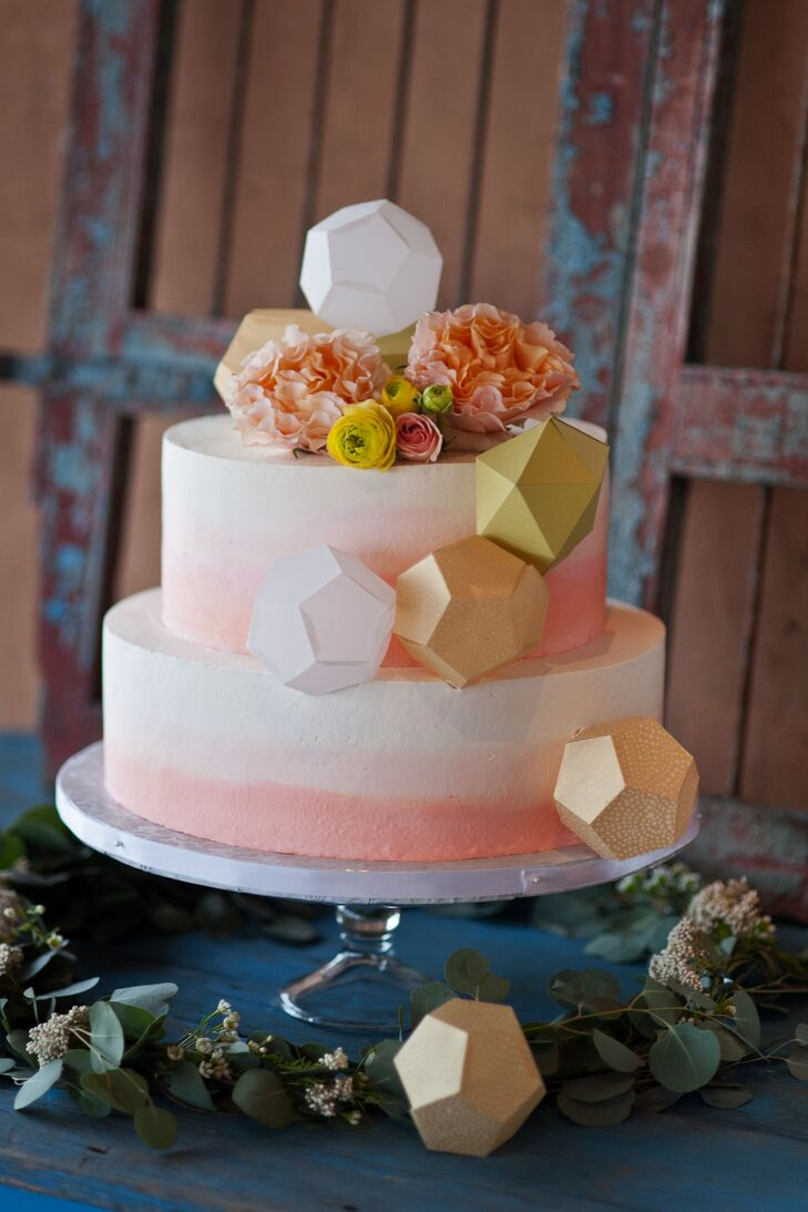 Minh and Miguel wanted a simple cake with ombre frosting of white and coral; Minh embellished the cake with handmade origami prisms and flowers. Nhan Pham made a vanilla and devil's food cake with raspberry Bavarian and vanilla cream filling, which was a hit with the party guests.