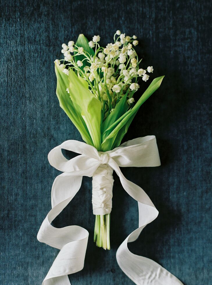 """I have always loved lilies of the valley and wanted to have a delicate bunch of flowers to carry,"" Liv says. Liv's mother, June, who is a floral designer, created a dainty bouquet of lilies of the valley for Liv's walk down the aisle. For a bit of extra oomph, she tied the bouquet with a length of silky ivory ribbon."