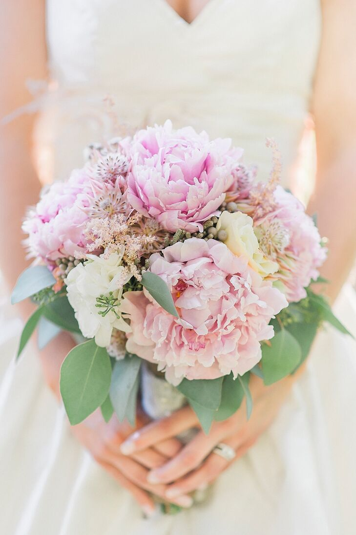 Pastel pink peonies added a soft, romantic touch to the bridal bouquet.
