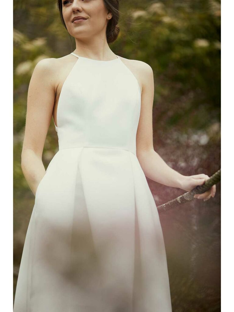 Short simple boxy wedding dress with pockets and high neckline