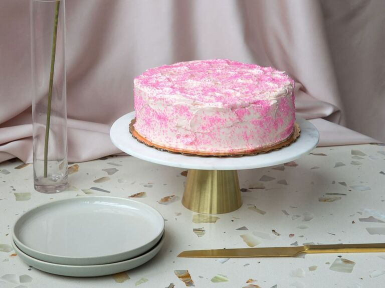 White and gold marble wedding cake stand with single-tier pink and white cake
