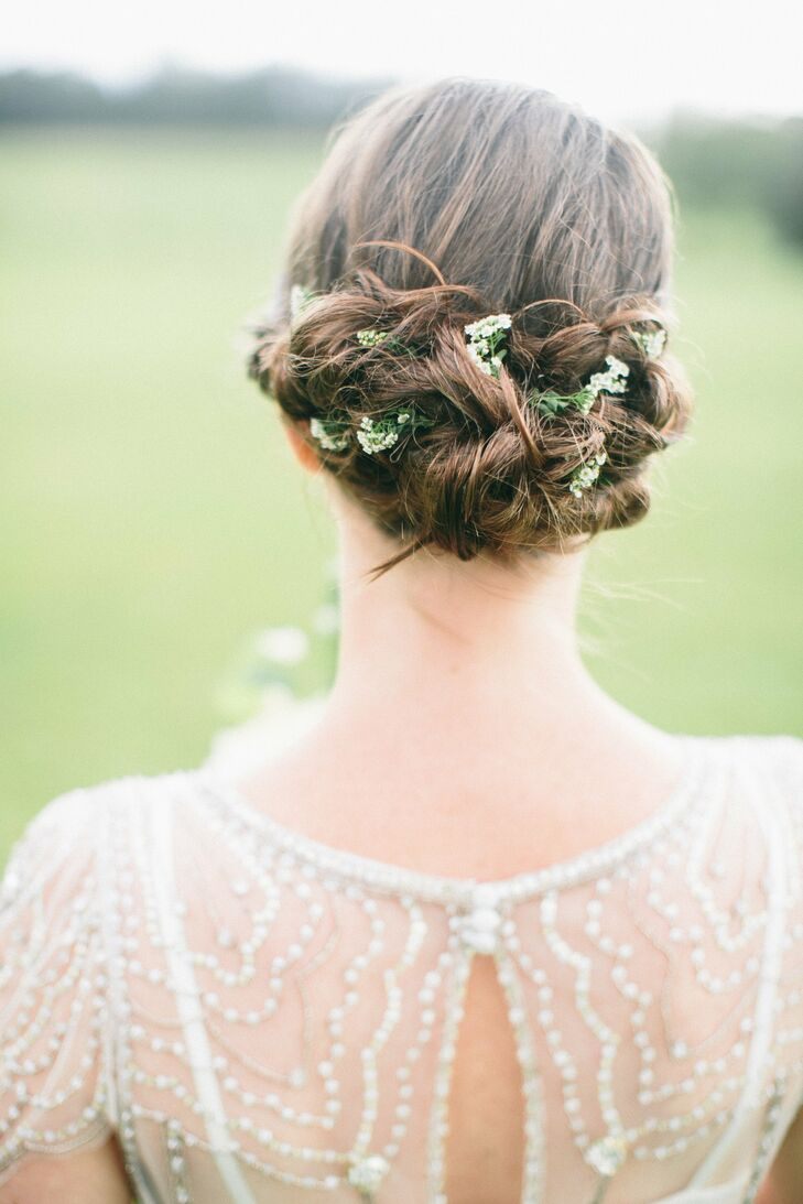 For a bohemian look, Julia laced flowers between strands of her hair in her low updo.
