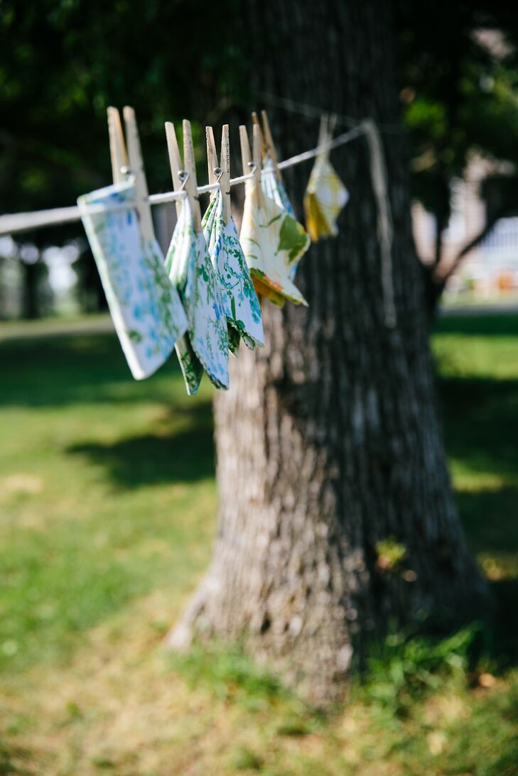 To go with their retro homespun wedding, Katie and Matt hung folded linen napkins on a clothesline with each guest's name wood-burned into the clothespin. The alternative escort cards were an adorable twist on tradition, and such a fun way for guests to find their seats.