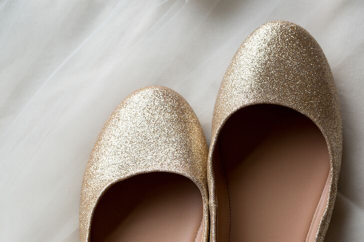 The bride slipped on inexpensive glittery gold flats with her beaded dress.