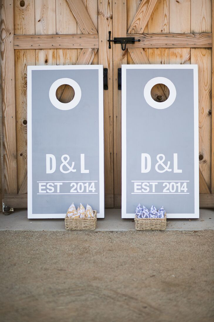 Lauren's siblings contributed to the day's entertainment by building custom gray and white cornhole boards. They personalized the props with Lauren and Drake's initials on the front.