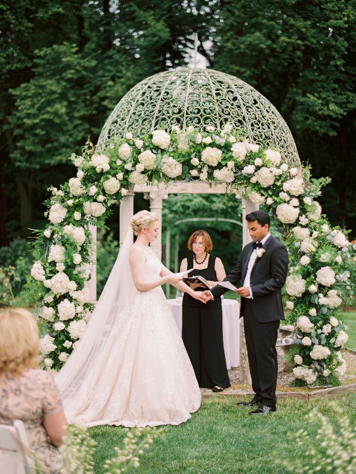 Couple Under Botanical Circular Arch with Officiant