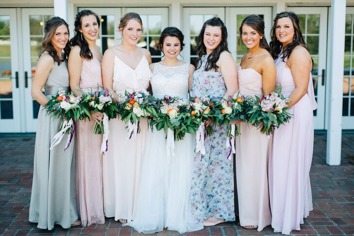 "Continuing the elegantly eclectic theme that popped up throughout the day, Hope allowed her bridesmaids to choose their own long pastel gowns to create a striking mismatched aesthetic. ""I let them pick their own dresses because I wanted them to feel beautiful, comfortable and happy,"" Hope says. ""I mentioned neutral or pink tones, and they took it from there. My sister went with a floral blue-toned dress, which ended up so much better than I imagined."""