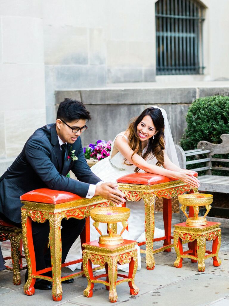 Bride and groom during religious wedding ceremony
