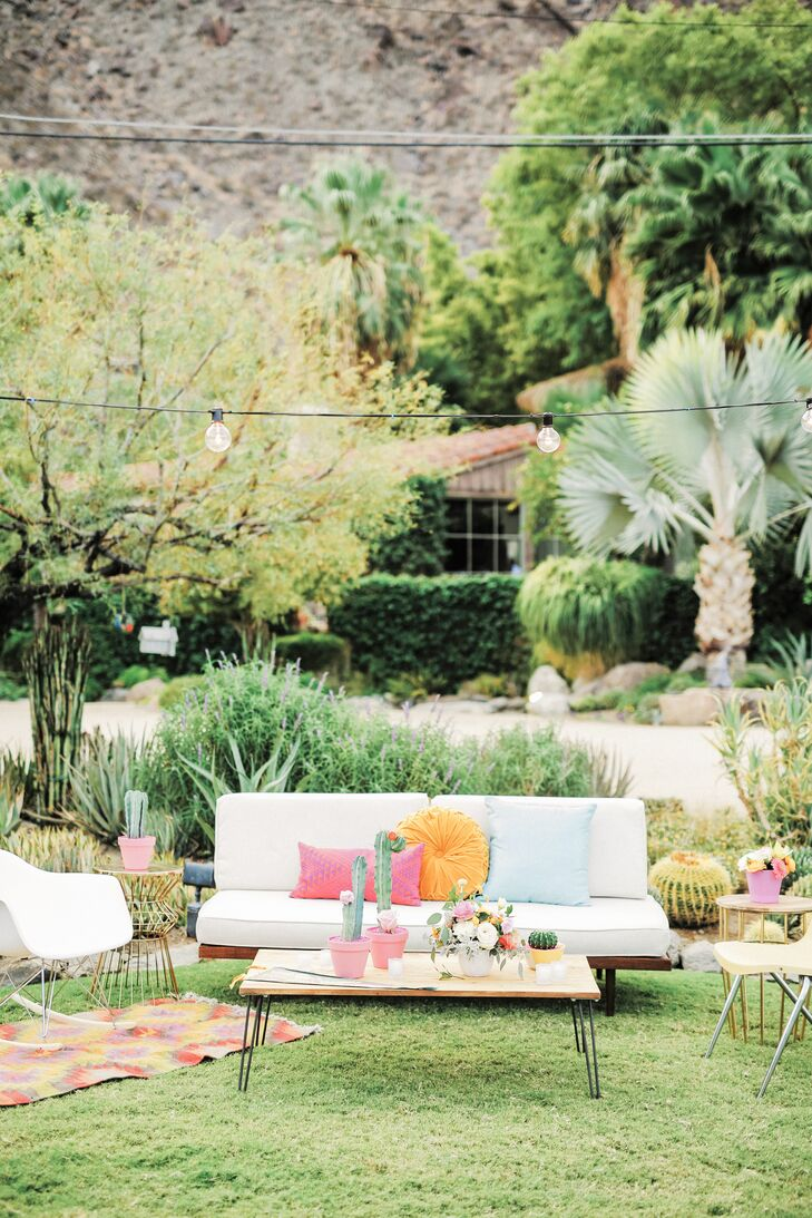 After the ceremony, guests could kick back with a cocktail on white couches and chairs decorated with bright pink, yellow and ice blue throw pillows (all of which matched the event's vibrant palette).