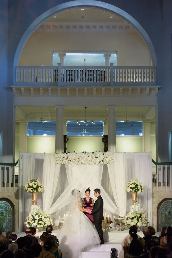 Elegant Altar With White Blooms and Backdrop