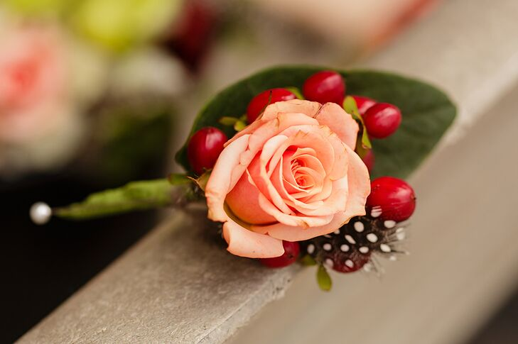Coral Rose With Red Hypericum Berry Boutonniere