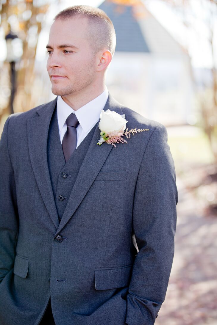 Michael wore a three piece, charcoal gray suit with a gray tie and a white rose boutonniere.