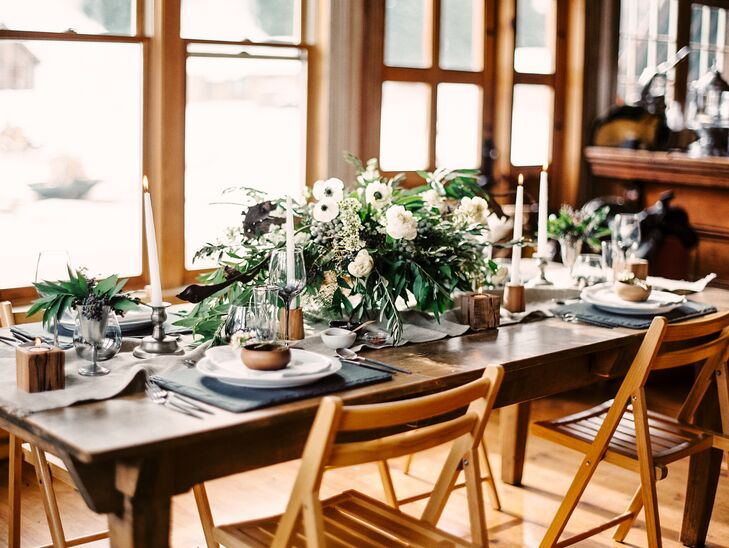 With unadorned, wooden tables, the couple kept their decorations simple but elegant. Long, white tapered candles lit the tables and white and green centerpieces brought in florals with a masculine edge.