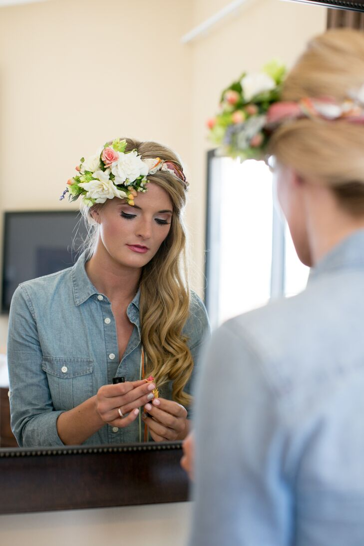 Megan wanted to keep her look simple and true to herself. So she used the same hairdresser she's been going to for years to style her hair in a wavy side style. She completed her look with the perfect white gardenia, blush rose, peach hypericum berry crown and a bright pink lip.