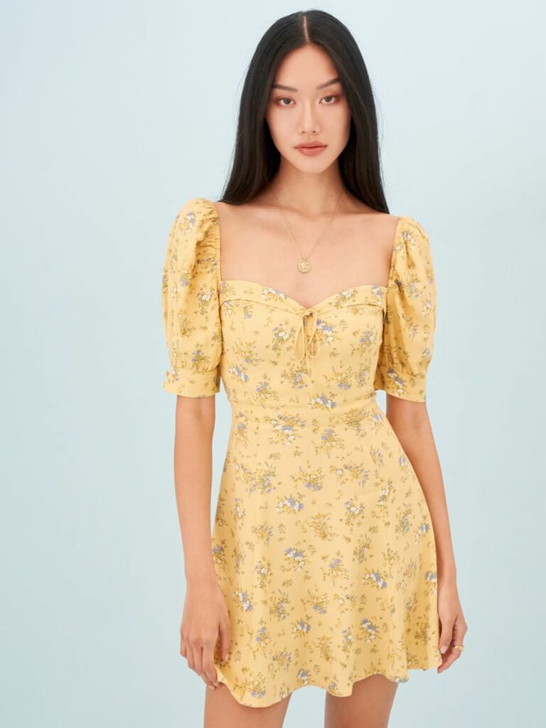 Yellow mini cottagecore dress with bustier-inspired bodice and puff sleeves