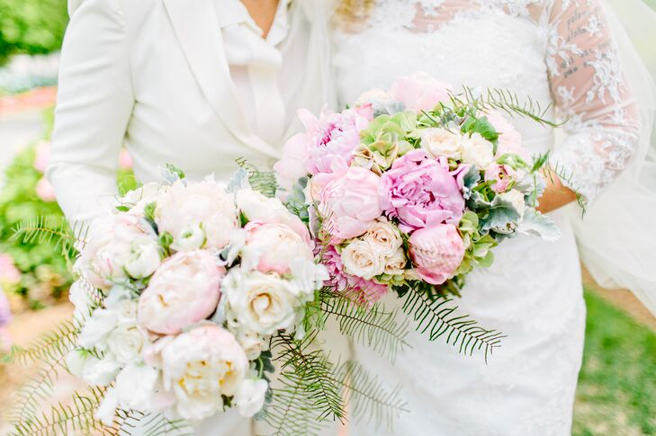 For Louise and Katie's bouquets, Karen of Lilac Florals designed two complementary arrangements of roses, peonies, ranunculuses, spray ferns and dusty miller in soft shades of pink, blush, cream, green and silvery blue.