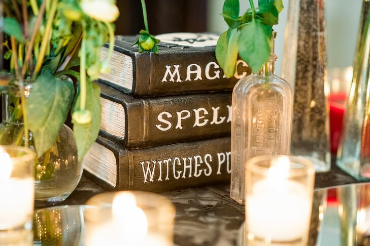 Each table was named for an element from the periodic table (such as copper, mercury and gold) and spotlighted centerpieces crafted from black curly willow, stacks of vintage magic and witchcraft books and apothecary bell jars filled with tiny lights.