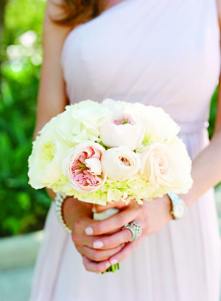 All seven of Jessica's bridesmaids carried petite versions of her own bouquet. The pale-pink peonies, white roses and hydrangeas complemented their soft pink gowns perfectly.