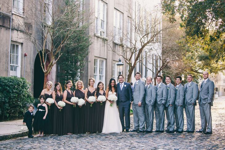 """We wanted a timeless-classic look for our wedding,"" Christina says. ""We went with a black, white, off-white, gray and silver color scheme. I chose a slate gray bridesmaid dress by Dessy. The dress was able to be tied at the top in hundreds of different styles. I loved this option, because it was long and flattered all body types. Our groomsmen wore light gray suits."""