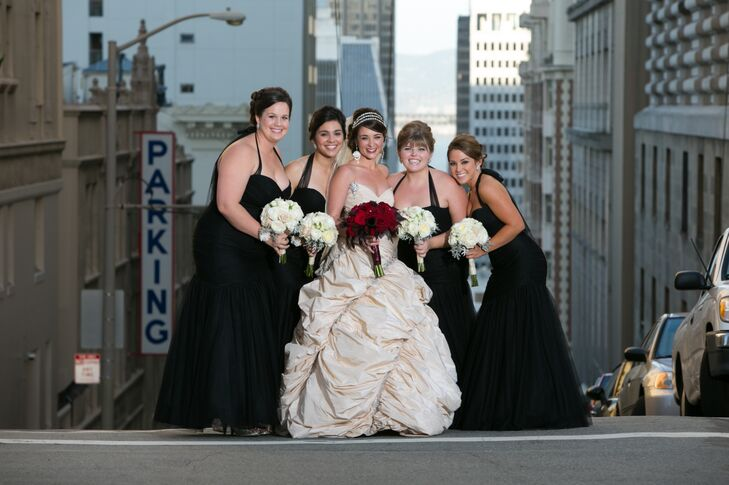 Nicole stood next to her bridesmaids, who wore long black dresses designed by Watters.