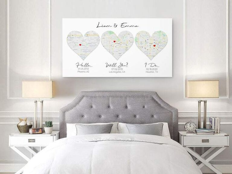 Canvas map art with three hearts showing where couple met, got engaged and got married