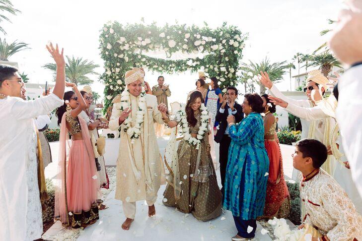 Couple Recessing as Guests Toss Rose Petals