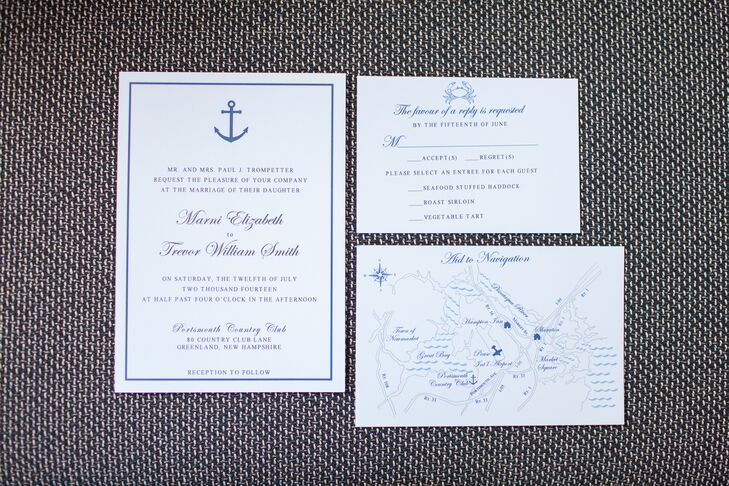 The white and navy invitations suite had small illustrations of nautical elements like an anchor and a crab at the top.