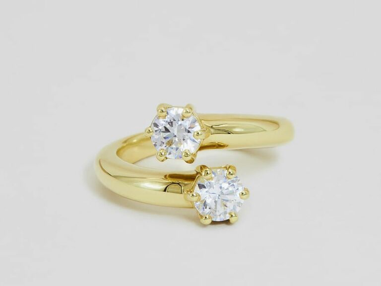 round cut diamond two stone ring in yellow gold setting