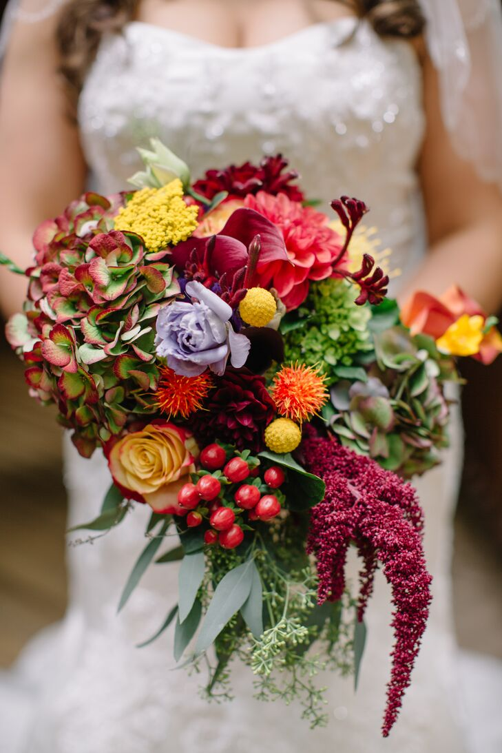 "Katie's stunning fall bouquet contains green hydrangeas, dahlias, gypsy curiosa roses, seeded eucalyptus, craspedia, freesias, mini calla lilies, kangaroo paws, hanging amaranthus, safflowers, lisianthus, yarrow and hypericum berries. ""I cried when I saw my bouquet, because it was so beautiful,"" Katie says."