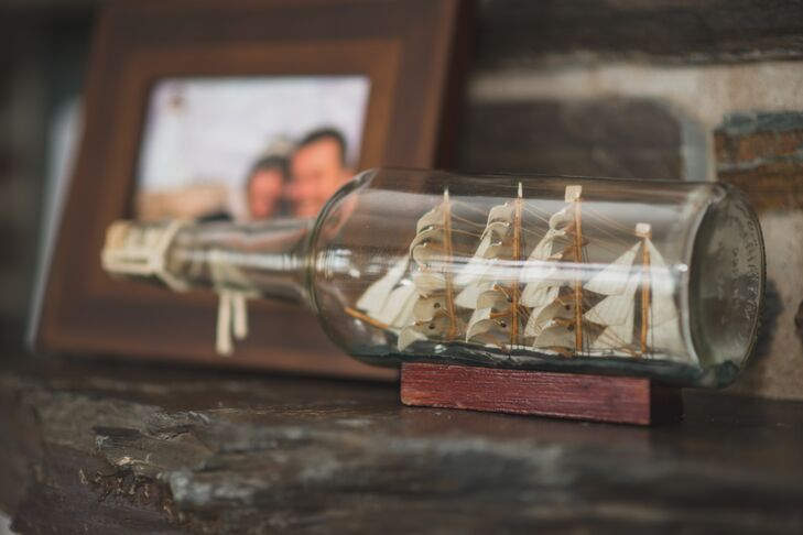 A tiny ship in a bottle added a nautical touch to the ceremony and reception decor.