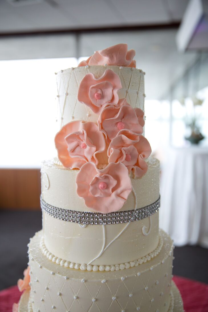 Their wedding cake from Josef's European Pastry Shop was classic on the inside with chocolate and vanilla marble cake. Its decoration, however, was completely different. Every ivory tier was decorated with either Swiss dots, a rhinestone trim, large pink fondant flowers or all three.
