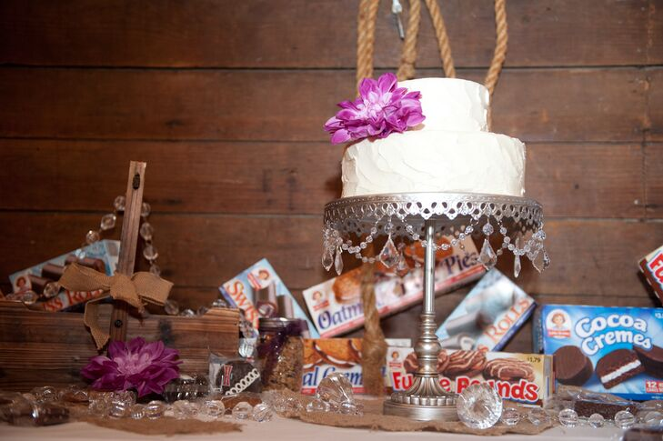 Besides a two-tier wedding cake decorated with purple flowers, Lisa and Jay decided to offer fun Little Debbie snack treats on their dessert table as well, keeping with the rustic and whimsical theme.