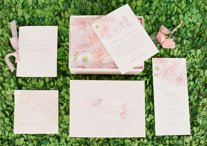 A custom botanical watercolor design by Inslee was a unifying element through the invitation suite.