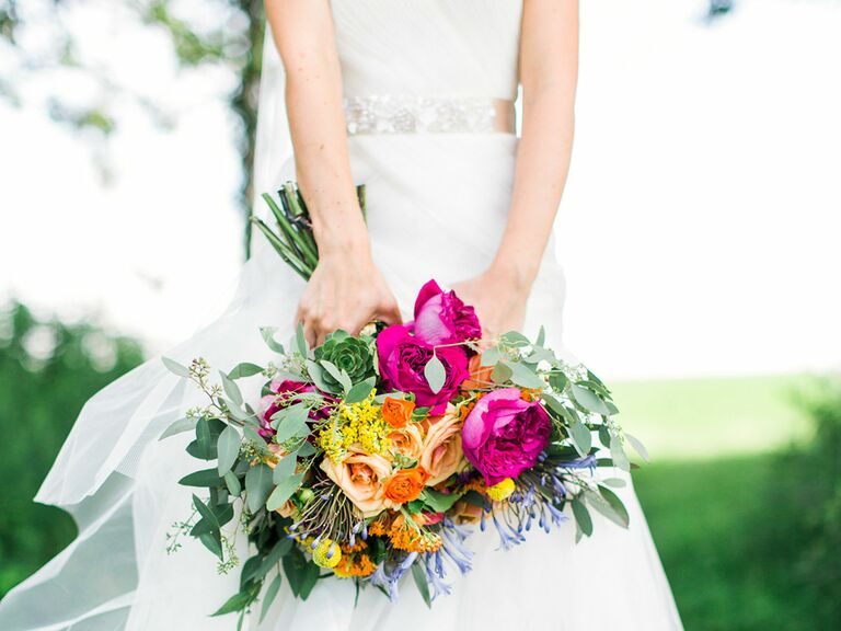 Brie Holding Bouquet With Yellow Peach And Magenta Flowers