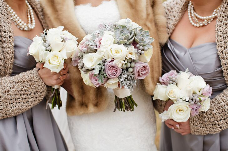 Amanda and her bridesmaids carried lavender and green bouquets filled with dusty miller, hypericum berries, roses and succulents.