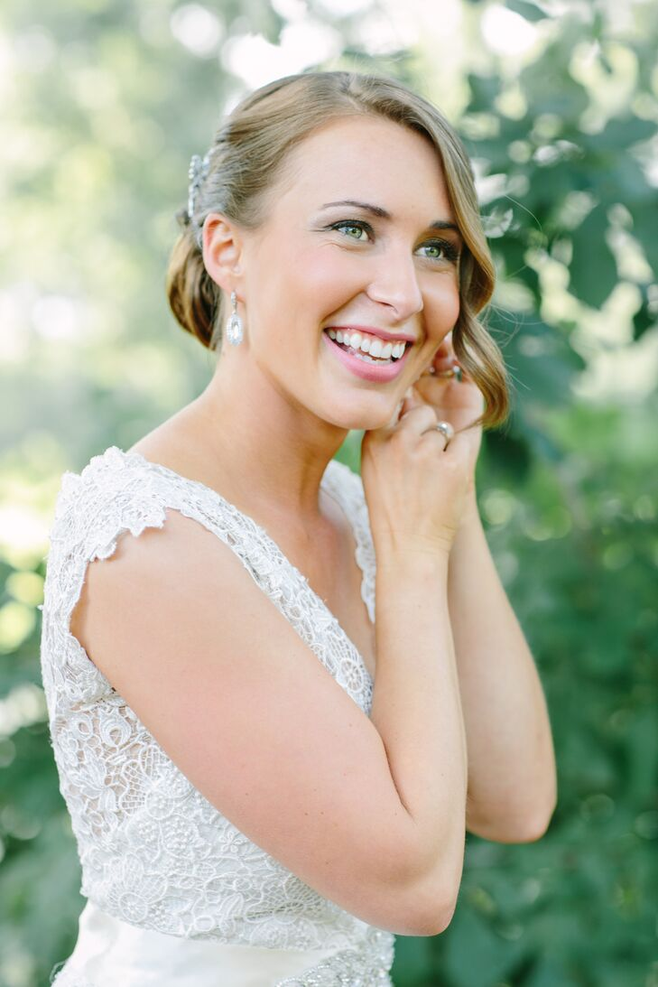 Lynn's bridal look was all about understated elegance. She kept the add-ons simple, donning an eye-catching pair of crystal drop earrings and accented her glam, side-swept updo with two shimmery clips and her mother's veil for the ceremony. For her makeup, she went for an elevated, natural look, making her green peepers pop with silvery liner and adding a warm glow with lightly dusted cheeks and a pink pout.