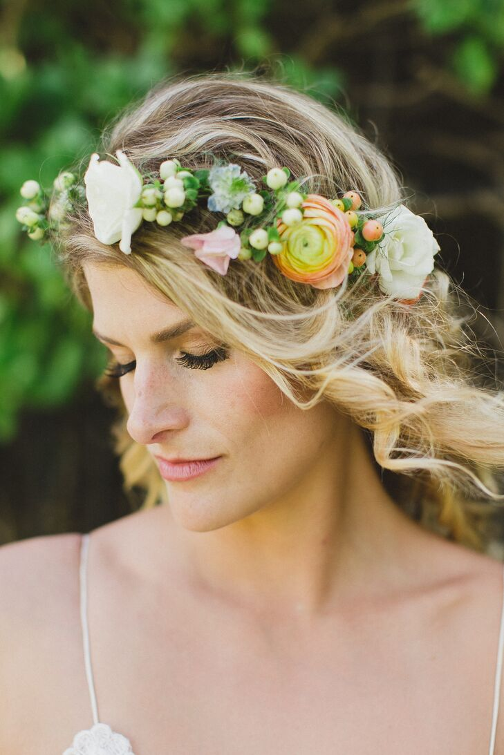 Tara wore her hair down for the wedding in loose romantic curls, which she topped off with rose, ranunculus and hypericum berry flower crown.