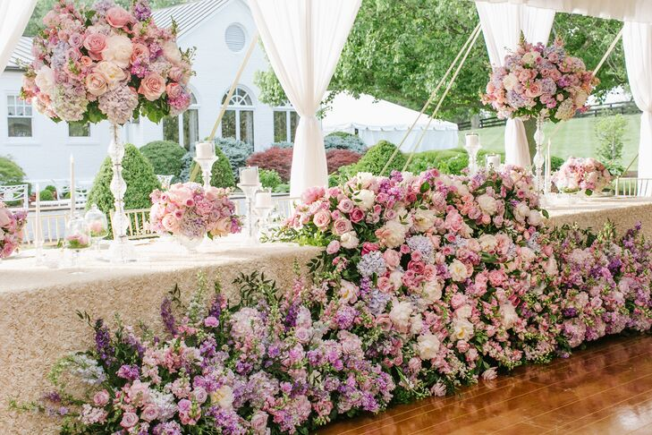 In line with the couple's fairy tale theme, florals evoked the feeling of an enchanted forest and were designed to look as though they were growing up from the floor, dramatically covering the king's table.