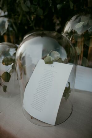 Eucalyptus and Seating Charts Under Glass Cloche