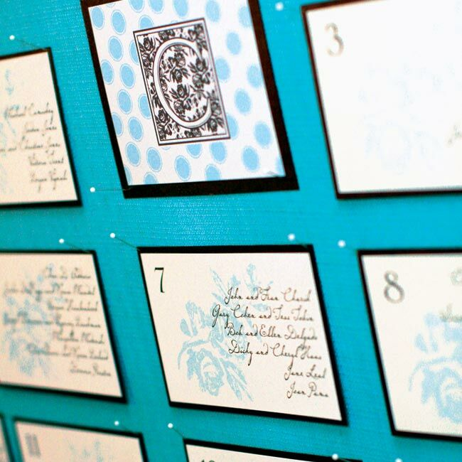 A seating chart showcased vintage-inspired cards, that were printed with each table number and the names of all the guests in attendance.